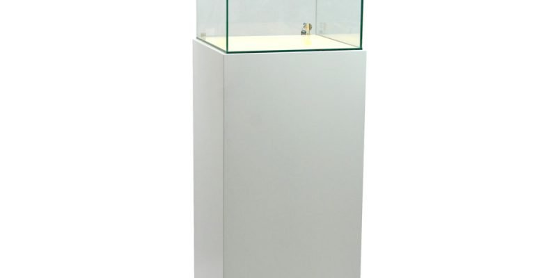 glass cabinet with a lit base lights on
